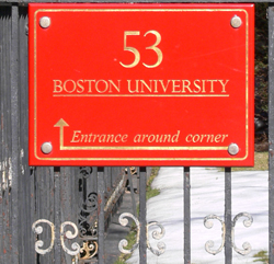 sign:entrance around corner